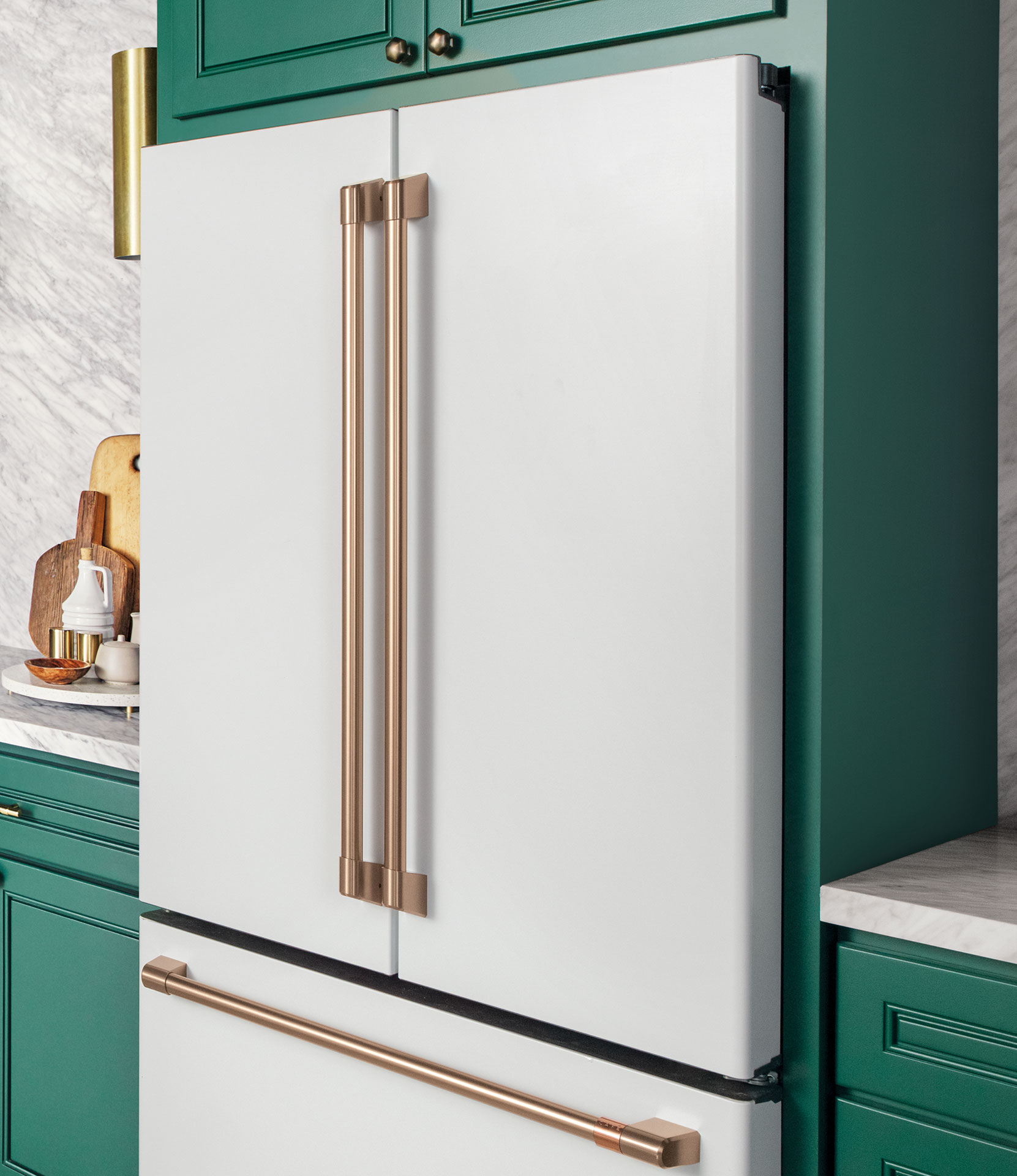 matte white french door refrigerator with green cabinets