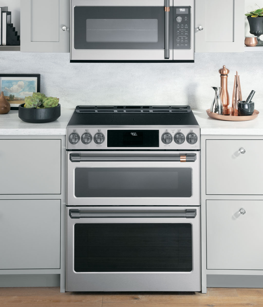 stainless steel double oven range with grey cabinets